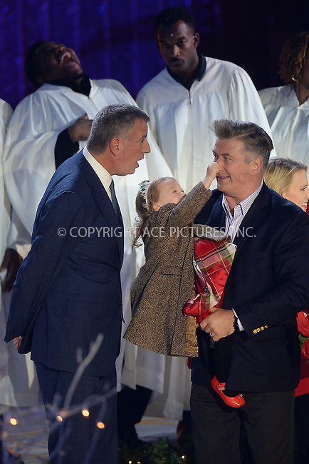 www.acepixs.com<br /> November 30, 2016  New York City<br /> <br /> Bill de Blasio, Carmen Baldwin, Alec Baldwin on stage at The Rockefeller Center Christmas Tree lighting ceremony on November 30, 2016 in New York City.<br /> <br /> <br /> Credit: Kristin Callahan/ACE Pictures<br /> <br /> <br /> Tel: 646 769 0430<br /> Email: info@acepixs.com