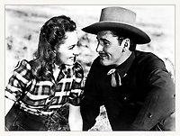 1939 American western film directed by Michael Curtiz and starring Errol Flynn, Olivia de Havilland, and Ann Sheridan. Based on a story by Robert Buckner, the film is about a Texas cattle agent who witnesses the brutal lawlessness of Dodge City, Kansas and takes the job of sheriff to clean the town up. Filmed in early Technicolor, Dodge City was one of the highest-grossing films of the year. This was the 7th of 11 movies that de Havilland and Flynn appeared in together. <br /> CAP/MPI/HPA<br /> ©HPA/MPI/Capital Pictures