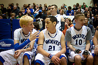 Grandview High School unified basketball teammates Shane Powell (cq, left) talks strategy with Michael Bush (cq, 21), next to Mathew Philippi (cq, 10), in a game against Overland High School at Grandview High School in Aurora, Colorado, Wednesday, February 1, 2012. Unified sports teams, an outgrowth of the Special Olympics, are teams with both special needs and traditional high school students as players. The idea is that special needs kids shouldn't be separated and be allowed to participate in a competitive games as well at their schools...Photo by Matt Nager