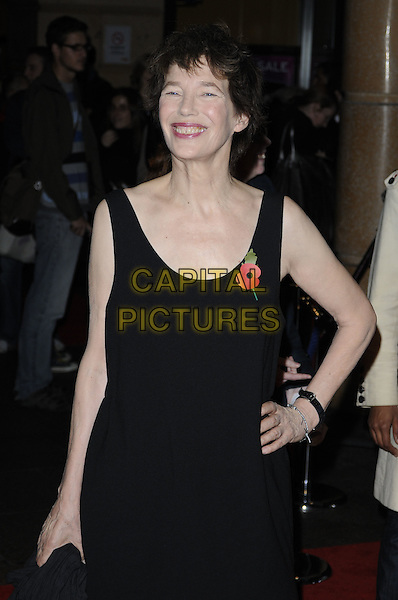 "JANE BIRKIN.The ""Around A Small Mountain"" gala screening, London Film Festival, Day 14, Vue West End Cinema, Leicester Square, London, England..October 27th, 2009.LFF half length black dress sleeveless poppy hand on hip smiling .CAP/CAN.©Can Nguyen/Capital Pictures."