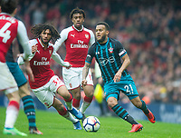 Southampton's Ryan Bertrand and Arsenal's Mohamed Elneny during the EPL - Premier League match between Arsenal and Southampton at the Emirates Stadium, London, England on 8 April 2018. Photo by Andrew Aleksiejczuk / PRiME Media Images.