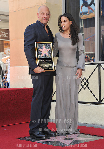 Vin Diesel &amp; Michelle Rodriguez on Hollywood Blvd where he was honored with the 2,504th star on the Hollwood Walk of Fame.<br /> August 26, 2013  Los Angeles, CA<br /> Picture: Paul Smith / Featureflash