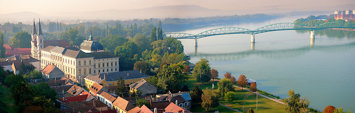 The Baroque Jesuit church and museum with the border bridge to Slovakia, Esztergom, Hungary (127mb)