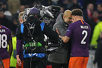 Manchester City Manager, Pep Guardiola shows his delight at the final whistle as he celebrates with Kyle Walker during Lyon vs Manchester City, UEFA Champions League Football at Groupama Stadium on 27th November 2018