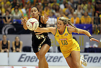 10.07.2011 Silver Ferns Maria Tutaia and Australia's Julie Corletto in action during the final netball match between the Silver Ferns v Australia at the Mission Foods World Netball Championship 2011 held at the Singapore Indoor Stadium in Singapore . Mandatory Photo Credit ©Michael Bradley.