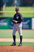 New York Yankees pitcher Jhony Brito (28) gets ready to deliver a pitch during a Florida Instructional League game against the Philadelphia Phillies on October 12, 2018 at Spectrum Field in Clearwater, Florida.  (Mike Janes/Four Seam Images)