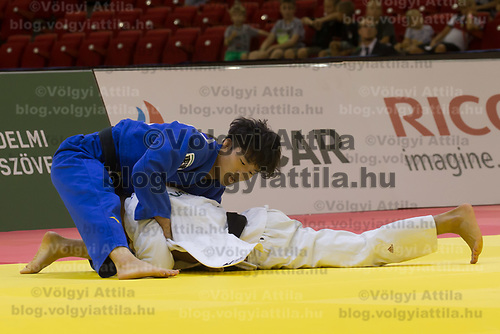 Kenzo Tagawa (top) of Japan and Mohamed Abdelmawgoud (bottom) of Egypt fight during the Men -66 kg category at the Judo Grand Prix Budapest 2018 international judo tournament held in Budapest, Hungary on Aug. 10, 2018. ATTILA VOLGYI
