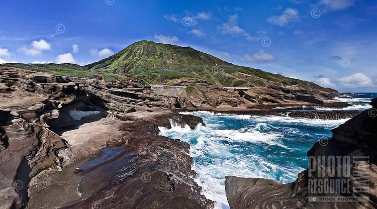 Beautiful view of Koko Crater viewed behind crashing waves along the coastline of O'ahu