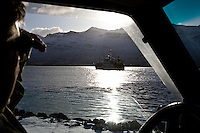 3)The engineer watches his trawler take a short trip around the fjord.