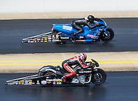 Sep 18, 2016; Concord, NC, USA; NHRA pro stock motorcycle rider Matt Smith (near) races alongside Jim Underdahl during the Carolina Nationals at zMax Dragway. Mandatory Credit: Mark J. Rebilas-USA TODAY Sports