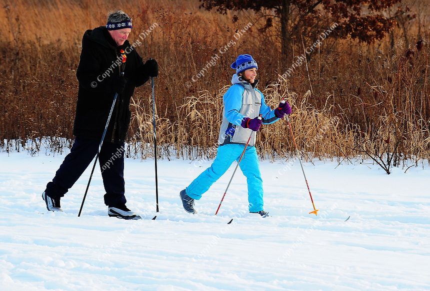 Bill and Sera Grimm ski along the open prairie in the Arboretum on Saturday in Madison