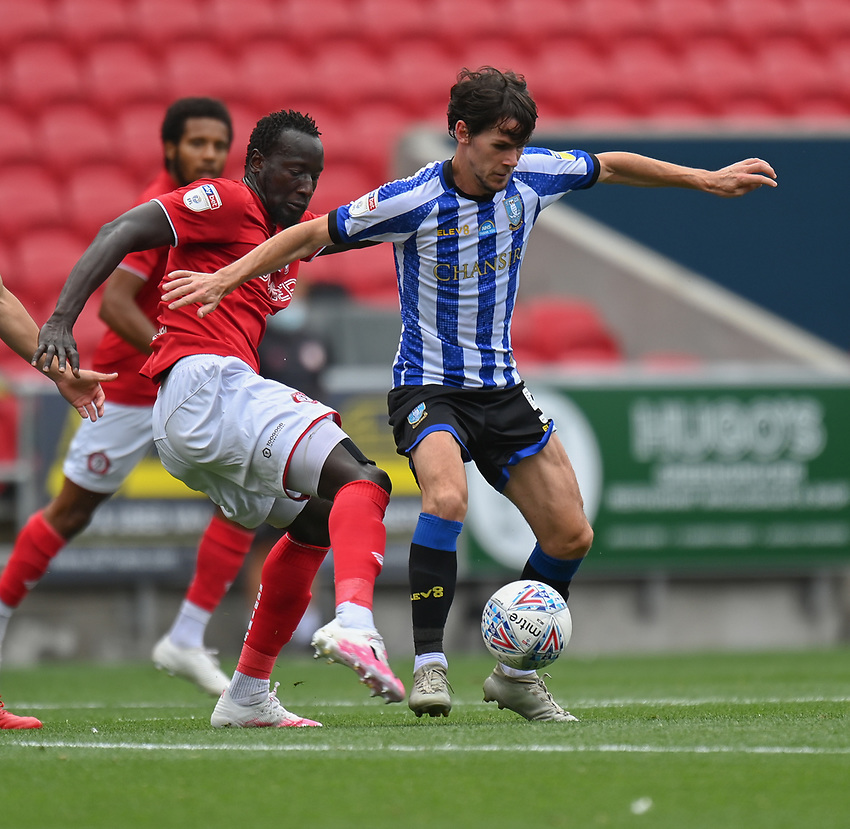Sheffield Wednesday's Kieran Lee (right) under pressure from Bristol City's Famara Diedhiou (left) <br /> <br /> Photographer David Horton/CameraSport<br /> <br /> The EFL Sky Bet Championship - Bristol City v Sheffield Wednesday - Sunday 28th June 2020 - Ashton Gate Stadium - Bristol <br /> <br /> World Copyright © 2020 CameraSport. All rights reserved. 43 Linden Ave. Countesthorpe. Leicester. England. LE8 5PG - Tel: +44 (0) 116 277 4147 - admin@camerasport.com - www.camerasport.com