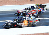 Mar 30, 2014; Las Vegas, NV, USA; NHRA funny car driver Cruz Pedregon (near) defeats Courtney Force during the Summitracing.com Nationals at The Strip at Las Vegas Motor Speedway. Mandatory Credit: Mark J. Rebilas-USA TODAY Sports
