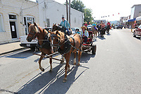 Wagons and horseback riders participate Friday, June 19, 2020, in the Harrison Roundup Club's WagonTrain. Nine wagons and 49 horses left the Northwest Arkansas District Fairgrounds in Harrison and traveled through downtown before heading out on a five-day and five night trip to Blue Springs located just east of Springdale. The annual wagon train, a tradition since 1977, normally would arrive to participate in the Rodeo of the Ozarks parade in Springdale but because of the covid-19 pandemic, the rodeo has been postponed. Visit nwaonline.com/200620Daily/ and nwadg.com/photos for a photo gallery.<br /> (NWA Democrat-Gazette/David Gottschalk)