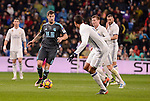 Real Madrid's Raphael Varane and Toni Kroos and Real Sociedad's Iñigo Martinez during La Liga match between Real Madrid and Real Sociedad at Santiago Bernabeu Stadium in Madrid, Spain. January 29, 2017. (ALTERPHOTOS/BorjaB.Hojas)
