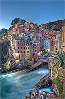 In the evening in Riomaggiore - in the Italian Cinque Terre - a national park - I like to sit on the rocks down by the harbor and watch the waves roll in and the tourists go by.