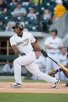 Dayan Viciedo (41) of the Charlotte Knights follows through on his swing against the Rochester Red Wings at BB&T BallPark on August 8, 2015 in Charlotte, North Carolina.  The Red Wings defeated the Knights 3-0.  (Brian Westerholt/Four Seam Images)