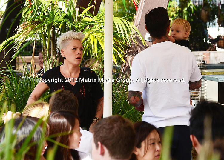 29 SEPTEMBER SYDNEY AUSTRALIA ..WORLD EXCLUSIVE PICTURES..Internationally acclaimed singer/ songwriter Pink [Alecia Beth Moore] who recently scored her first billboard no.1 with her song 'The Truth About Love' is pictured at Bungalow 8 bar having just finished lunch with her husband Carey Hart and daughter Willow. The singer then took in a leisurely walked while flanked by two burly bodyguards along King Street Wharf Darling Harbour to the Sydney Aquarium and Australian Wildlife Park where they were escorted past waiting crowds for the special VIP tour of both attractions. ....*No internet without clearance*.MUST CALL PRIOR TO USE ..+61 2 9211-1088.Matrix Media Group.Note: All editorial images subject to the following: For editorial use only. Additional clearance required for commercial, wireless, internet or promotional use.Images may not be altered or modified. Matrix Media Group makes no representations or warranties regarding names, trademarks or logos appearing in the images.