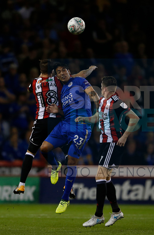 Kieron Freeman of Sheffield Utd keeps out Leonardo Ulloa of Leicester City during the Carabao Cup, second round match at Bramall Lane, Sheffield. Picture date 22nd August 2017. Picture credit should read: Simon Bellis/Sportimage