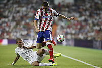 Pepe of Real Madrid and Siqueira of Atletico de Madrid during La Liga match between Real Madrid and Atletico de Madrid at Santiago Bernabeu stadium in Madrid, Spain. September 13, 2014. (ALTERPHOTOS/Caro Marin)
