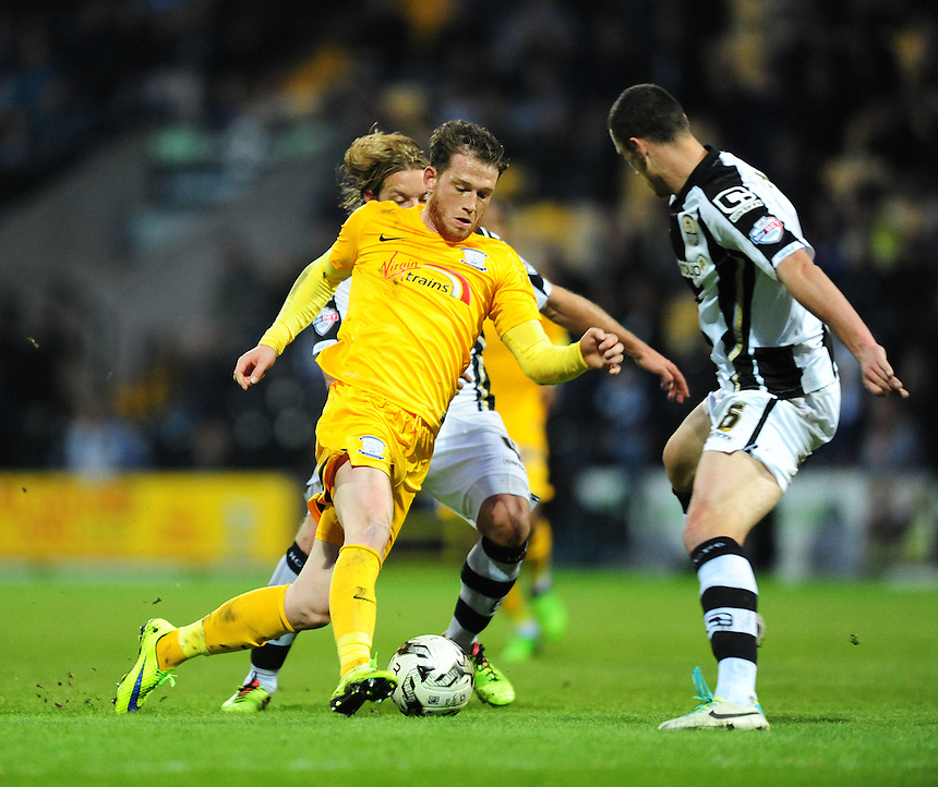 Preston North End's Joe Garner looks for a way past Notts County's Alan Smith, left, and Notts County's Haydn Hollis<br /> <br /> Photographer Chris Vaughan/CameraSport<br /> <br /> Football - The Football League Sky Bet League One - Notts County v Preston North End - Tuesday 21st April 2015 - Meadow Lane - Nottingham<br /> <br /> &copy; CameraSport - 43 Linden Ave. Countesthorpe. Leicester. England. LE8 5PG - Tel: +44 (0) 116 277 4147 - admin@camerasport.com - www.camerasport.com