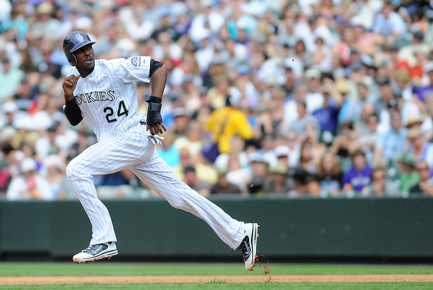 21 AUGUST 2011:    Colorado Rockies center fielder Dexter Fowler (24) attempts a steal of second base during a regular season game between the Los Angeles Dodgers and the Colorado Rockies at Coors Field in Denver, Colorado. The Rockies beat the Dodgers 5-3. *****For Editorial Use Only*****