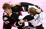 Iowa Chops' Troy Bodie, left, trades punches with Milwaukee's Scott Ford during the first period Saturday, March 1, 2009 at Wells Fargo Arena.  With red colored ice, it was 'Go Red' Night in support of heart health awareness.