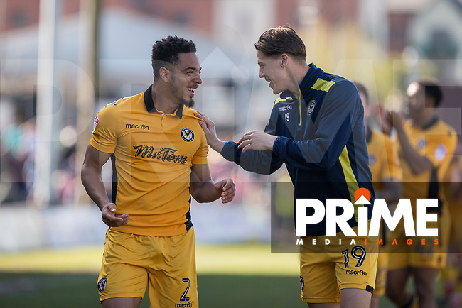 Jazzi Barnum-Bobb and Sid Nelson of Newport County celebrate at full time of the Sky Bet League 2 match between Newport County and Accrington Stanley at Rodney Parade, Newport, Wales on 22 April 2017. Photo by Mark  Hawkins.