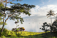 Lake Toba (Danau Toba) and fishing boats at sunrise, North Sumatra, Indonesia