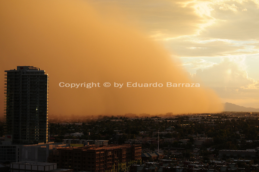 """Phoenix, Arizona (September 6, 2014) -- The dust storm is seen blowing in the South Phoenix area from the neighboring city of Tempe. The huge wall quickly blanketed the area, highly blocking the visibility. A massive dust storm sweeps into the Phoenix metropolitan area blanketing the Valley. The phenomenon created a massive wall of dust, also called """"baboob"""". The dust storm was followed by thunderstorms producing very heavy rain.  Photo by Eduardo Barraza © 2014"""