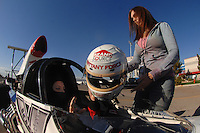 "Jan 20, 2007; Las Vegas, NV, USA; NHRA Super Comp driver Brittany Force is handed her helmet from her mother Lauri Force during preseason testing at ""The Strip"" at Las Vegas Motor Speedway in Las Vegas, NV. Mandatory Credit: Mark J. Rebilas"