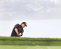 25 JAN 13 Fan favorite Phil Mickelson in the steady rain during Friday's Second Round action  at The Farmers Insurance Open at Torrey Pines Golf Course in La Jolla, California. (photo:  kenneth e.dennis / kendennisphoto.com)