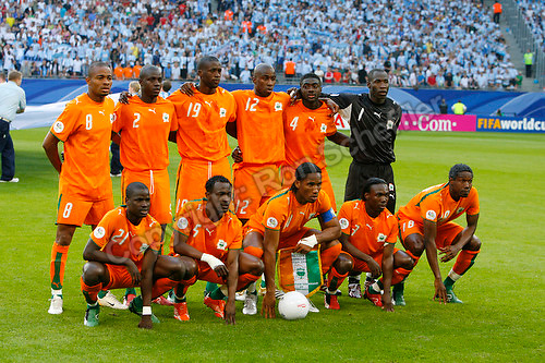 Jun 10, 2006; Hamburg, GERMANY; The Ivory Coast starting eleven pose for photos prior to the match against Argentina in first round group C play of the 2006 FIFA World Cup at FIFA World Cup Stadium Hamburg. Front row: defender (21) Emmanuel Eboue, midfielder (5) Didier Zokora, forward (11) Didier Drogba, defender (3) Arthur Boka and midfielder (18) Kader Keita. Back row: forward (8) Bonaventure Kalou, midfielder (2) Kanga Akale, midfielder (19) Yaya Toure, defender (12) Abdoulaye Meite, defender (4) Kolo Toure and goalkeeper (1) Jean-Jacques Tizie. Argentina defeated the Ivory Coast 2-1. Mandatory Credit: Ron Scheffler-US PRESSWIRE Copyright © Ron Scheffler.
