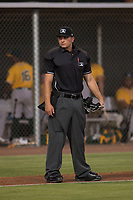 Home plate umpire Kevin Levine during an Arizona League game between the AZL Giants Black and the AZL Athletics at the San Francisco Giants Training Complex on June 19, 2018 in Scottsdale, Arizona. AZL Athletics defeated AZL Giants Black 8-3. (Zachary Lucy/Four Seam Images)