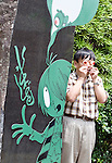 Shigeru Mizuki street in Sakaiminato, Tottori Prefecture, Japan..Photographer: Robert GilhoolyA man has his photo taken while holding a confectionary item modeled on a character in Gegege no Kitaro by Shigeru Mizuki outside a museum dedicated to the manga artist in his home town of Sakaiminato, Tottori Prefecture, Japan. .Photographer: Robert Gilhooly