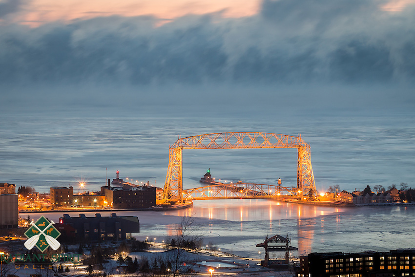 &quot;Making Ice&quot;<br /> As the lake was making ice, her breath could be seen in the subzero air. The sea smoke is caused by evaporative cooling -- the cold air temperature and warmer open water of Lake Superior create this beautiful type of winter fog. Duluth winters are strikingly beautiful! On this particular morning, the air temperature was about 15 below zero Fahrenheit.
