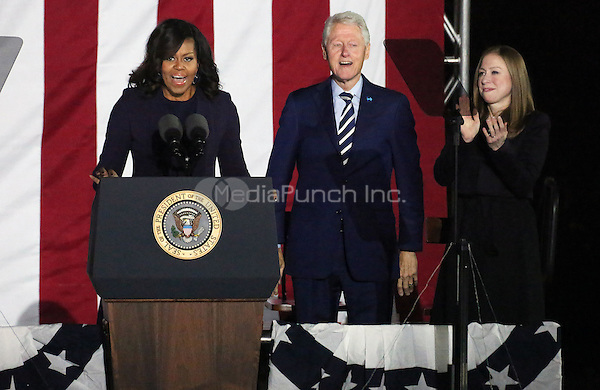 PHILADELPHIA, PA - NOVEMBER 7: First Lady, Michelle Obama, Bill Clinton and Chelsea Clinton at the GOTV Rally in support of Hillary Clinton for President at Independence Mall in Philadelphia, Pennsylvania on November 7, 2016. Credit: Star Shooter/MediaPunch