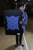 New York, NY, USA - June 24, 2011: Esmé Cribb, original Origami designer and folder from Brooklyn at the OrigamiUSA Convention in New York City holding a tessellation design she created.