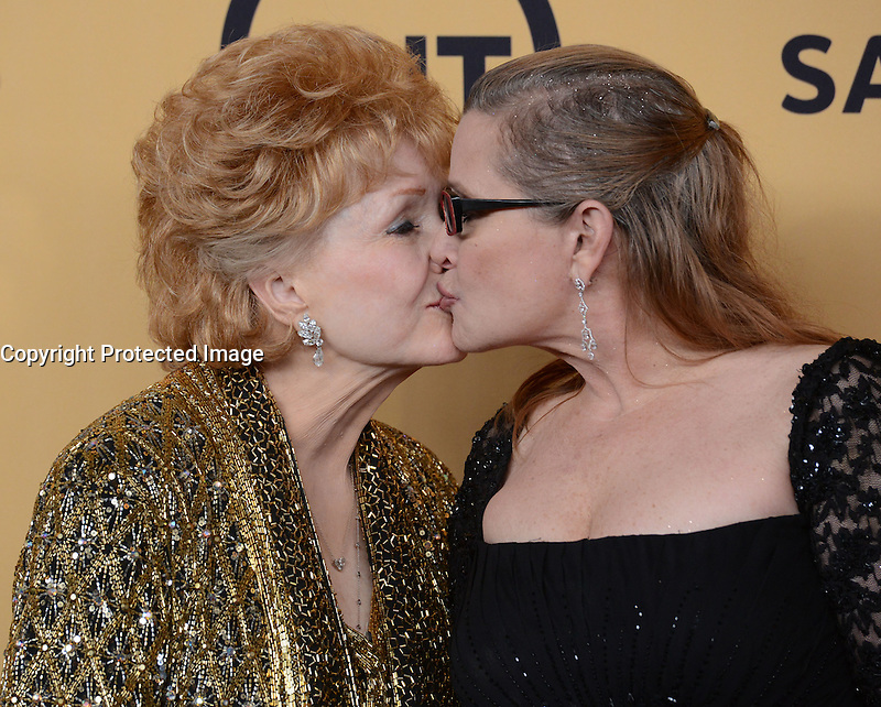 DEBBIE REYNOLDS + CARRIE FISHER @ the 21st Screen Actors Guild Awards held @ the Shrine auditorium.<br /> January 25, 2015