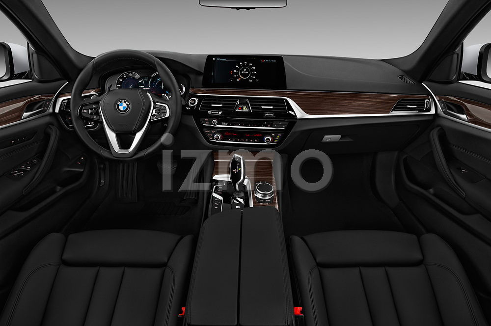 Stock photo of straight dashboard view of a 2018 BMW 5 Series 530e iPerformance 4 Door Sedan