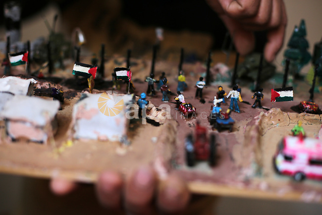 """Palestinian artist Majdi Abu Takeya, 39, converts gunshots used by the Israeli security forces against Palestinian protesters to small pieces of art knows as """"Art of thumbnails"""" at his house in Nuseirat in the central Gaza Strip, on February 16, 2019. Photo by Dawoud Abo Alkas"""
