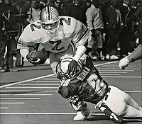 OSU's Cris Carter (#2) 10 yard gain on pass by Jim Karsatos. Tackle Wisconsin Pete Nowka 1986. (Dispatch photo by Fred Squillante)