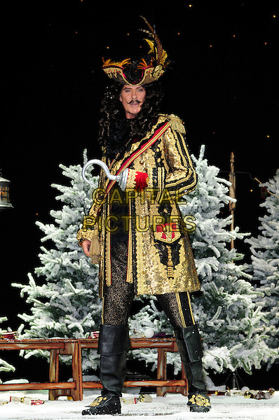 DAVID HASSELHOFF  .First Family Entertainment theatre company's annual group Pantomime photocall at Piccadilly Theatre, London, England..November 26th, 2010.stage costume panto pantomime full length captain hook gold wig jacket hat .CAP/CAS.©Bob Cass/Capital Pictures.