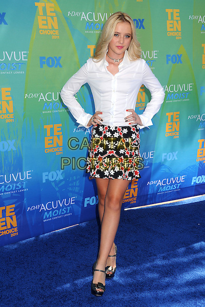 Kathryn Newton.2011 Teen Choice Awards - Arrivals held at Gibson Amphitheatre, , Universal City, California, USA..August 7th, 2011.full length white shirt black red print skirt hands on hips.CAP/ADM/BP .©Byron Purvis/AdMedia/Capital Pictures.