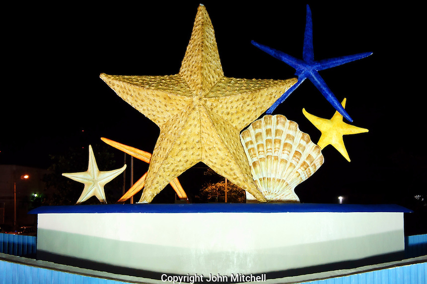 Plaza Caracoles fountain or Ceviche Square at night, starfish and seashells, corner of Avenida Tulum and Coba, Cancun, Quintana Roo, Mexico