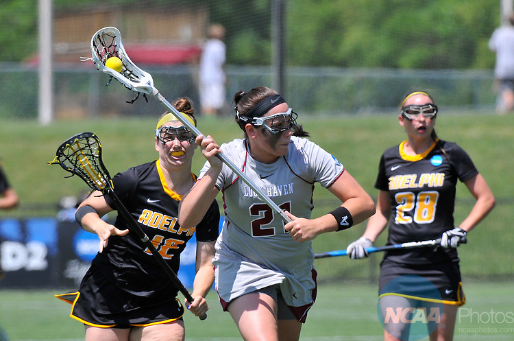 18 MAY 2014: Loch Haven's Chelsea Borrino (21)  is chased down by Adelphi University Ryley Weber (12)  in the final moments of the Division II Women's Lacrosse Championship held at Kerr Stadium in Salem, VA.  Adelphi defeated Lock Haven 7-5 to win the national title.  Andres Alonso/NCAA Photos