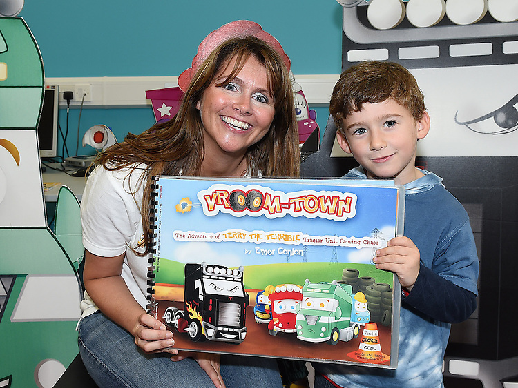 Author of the Vroom Town series of childrens books Emer Conlon pictured with OLiver Walsh at her Storytime Reading at the library in Drogheda. Photo:Colin Bell/pressphotos.ie