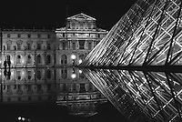 The courtyard of The Louvre, featuring I.M. Pei's Pyramid at its centre, Paris, France