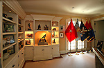 Trophies, including the 1958 Heisman and military flags decorate the home of Pete and Judi Dawkins in Rumson, New Jersey. CREDIT: Bill Denver for the Wall Street Journal..NYHODRUMSON