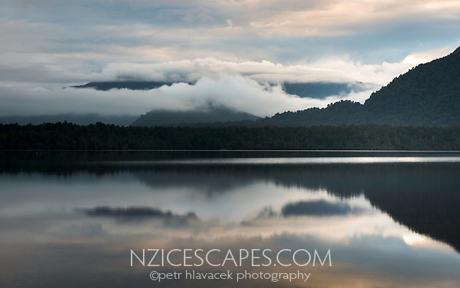 Moody sunrise at Lake Kaniere near Hokitika, West Coast, South Westland, South Island, New Zealand, NZ